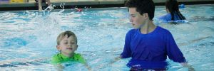 Kid swimming lessons at Excel Aquatics.