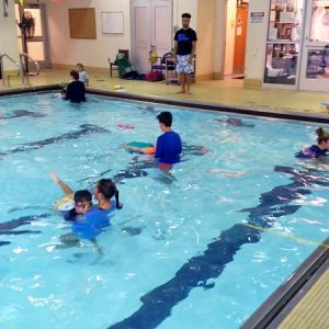 Kid swim lessons and programs are offered by Excel Aquatics.